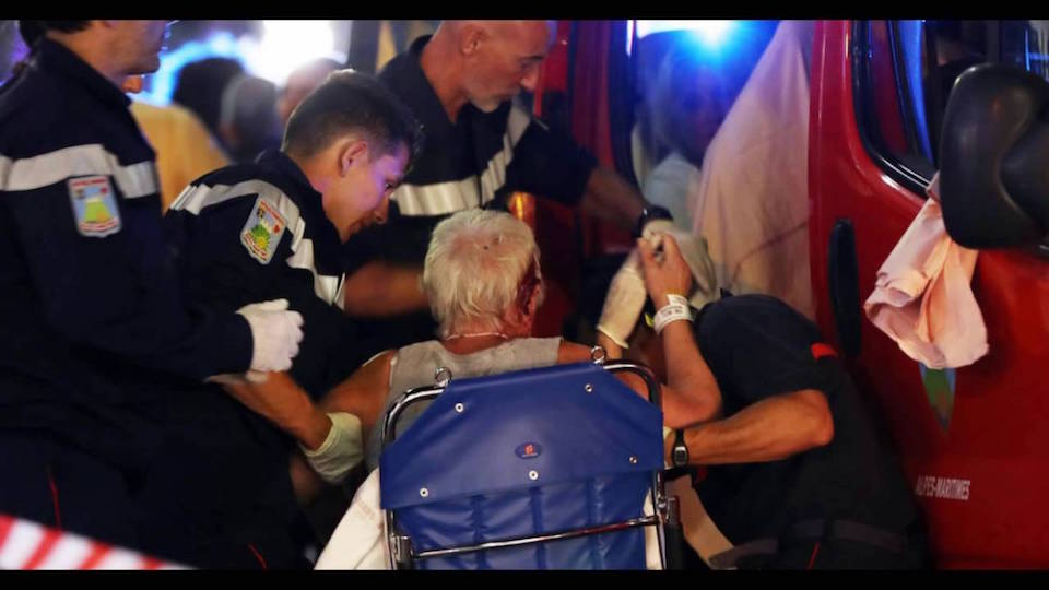 First aid staff assisting wounded woman in Nice