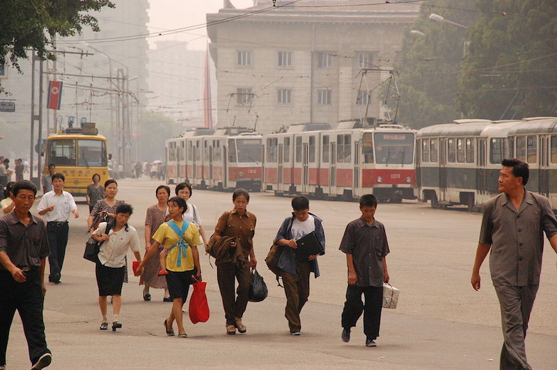 People walking on sidewalk in central Pyongyang