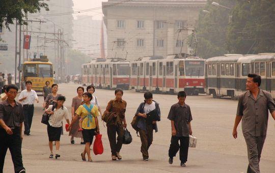 People walking on sidewalk in central Pyongyang