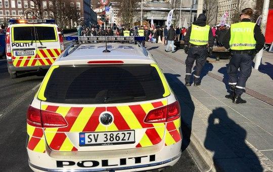 Norwegian police officers and Volkswagen and Mercedes-Benz cars in Bergen, Norway