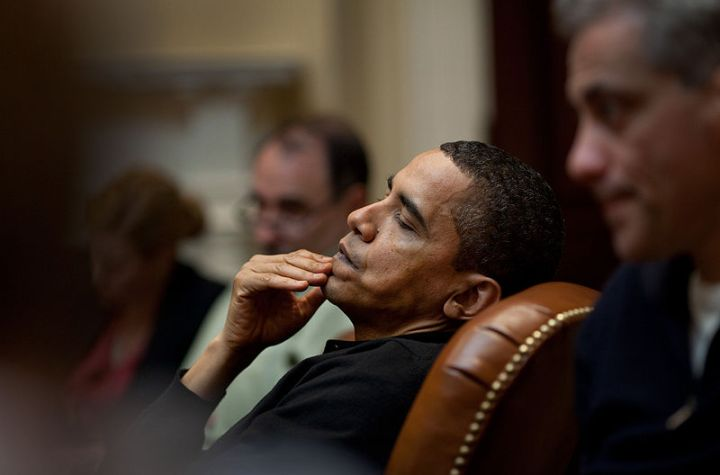 President of the United States of America Hussein Obama reflects during an economic meeting