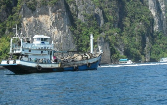 Garbage boat on Phi Phi Islands