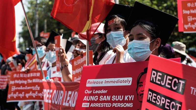 Release aung san suu kyi banners at protest in Myanmar against Military Coup