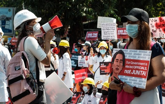 Demonstrators display banners during 2021 protests in Myanmar against Military Coup