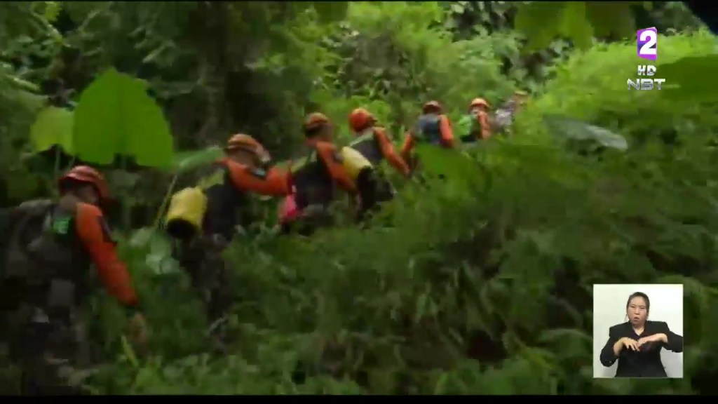 Rangers searching for potential entrances in Tham Luang cave, Chiang Rai