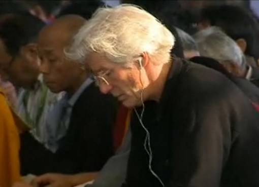 Richard Gere listening to the English translation of His Holiness the 14th Dalai Lama's teaching