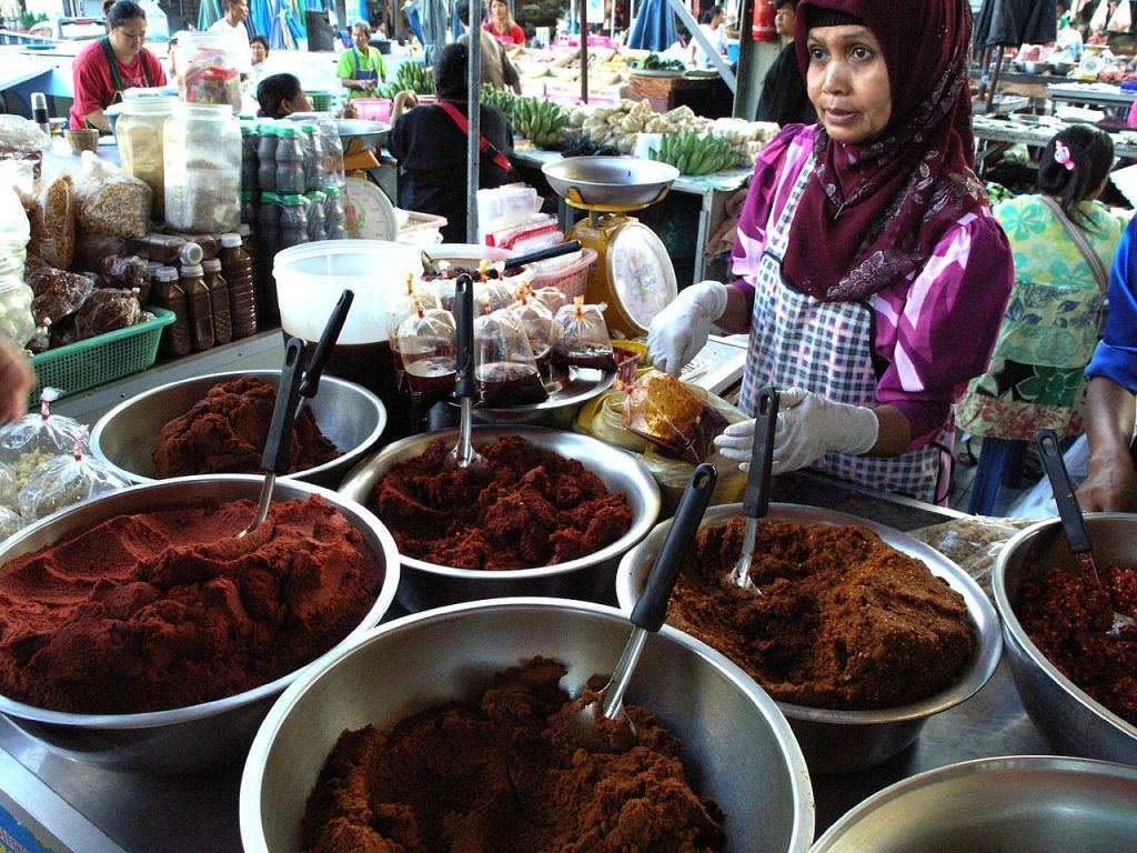 Malay-Muslim woman from Southern Thailand selling food at the market