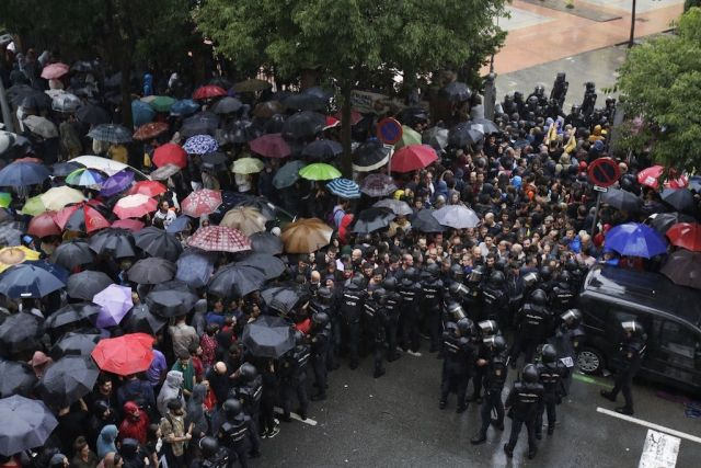People facing Spanish security forces in Barcelona