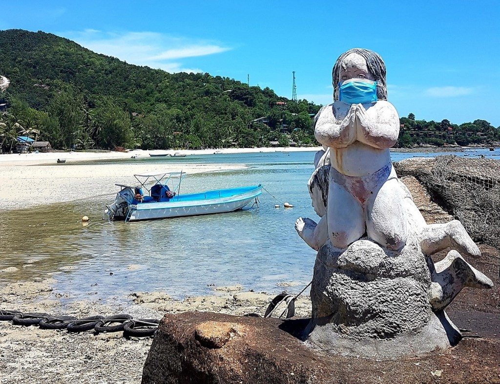 Statue wearing a face mask during the COVID-19 coronavirus outbreak in Thailand