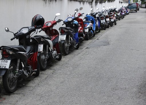 Parked motorcycles on a street in Thailand