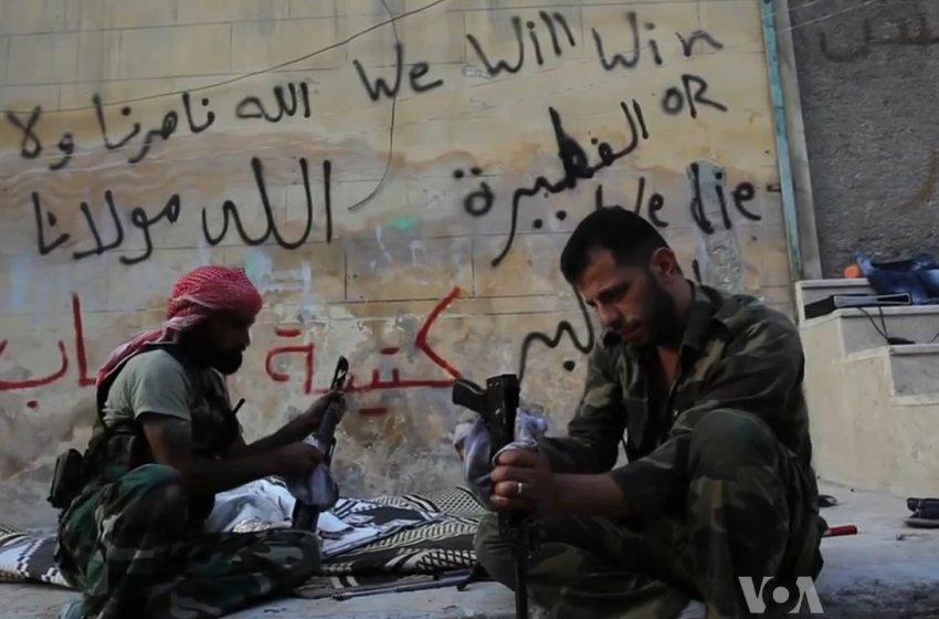 Free Syrian Army soldiers cleaning their AK-47s during the Battle of Aleppo