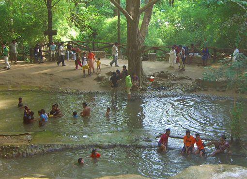 People bathing in a waterfall in Kanchanaburi