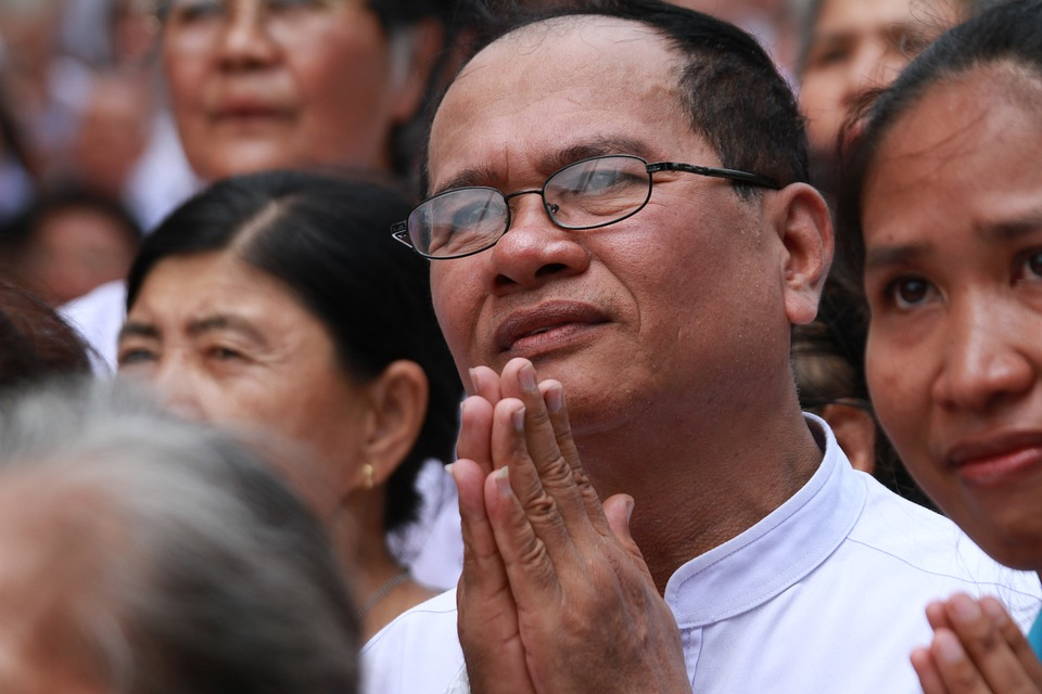 Buddhists praying at Thai temple