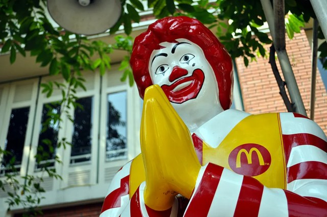 Fast food chain threatens legal action after model flashes panties with Ronald McDonald statue