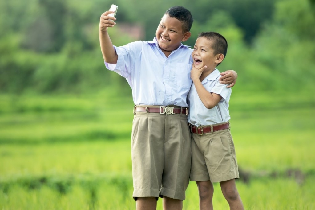 Two Thai schoolboys taking a selfie