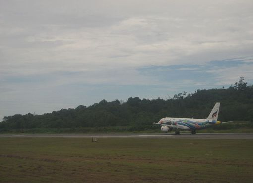 Aircraft taking off at Phuket international airport runway