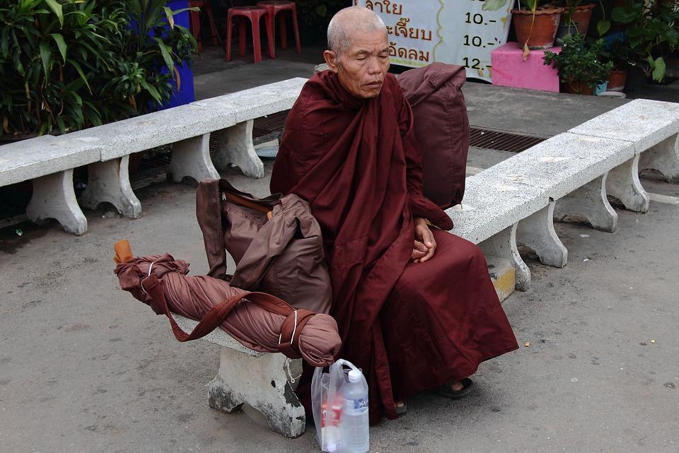Buddhist Monk sitting down
