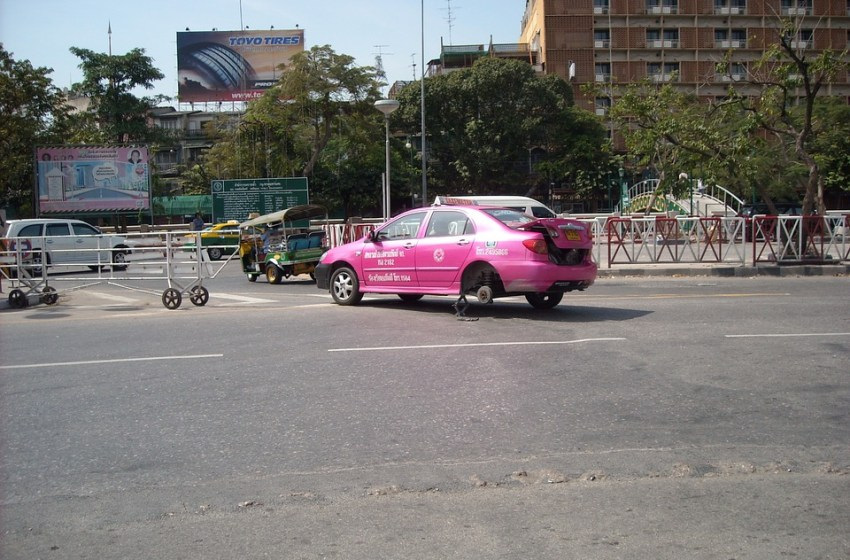 Pink taxi changing tires