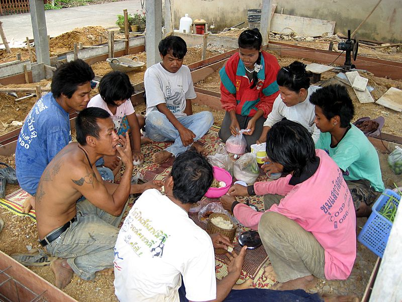 Thai workers having a lunch break on a construction site