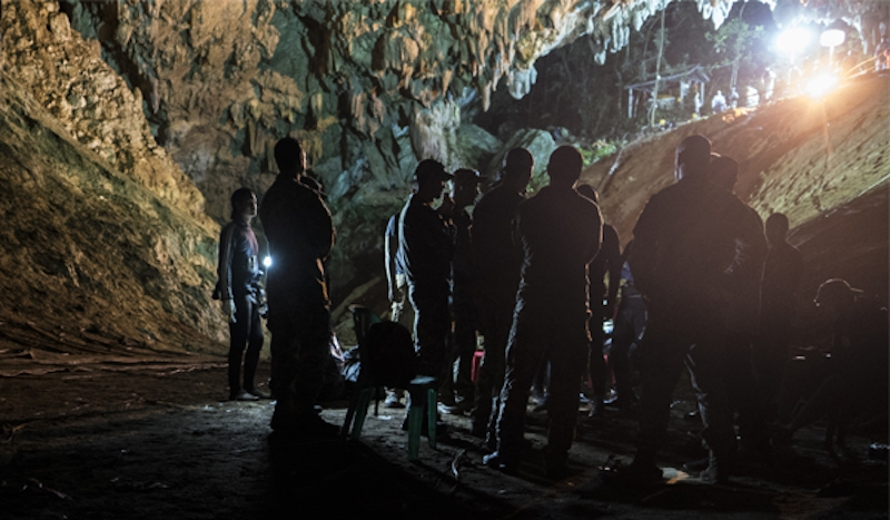 Airmen visit Tham Luang Cave in northern Thailand to meet with Royal Thai military officials and authorities