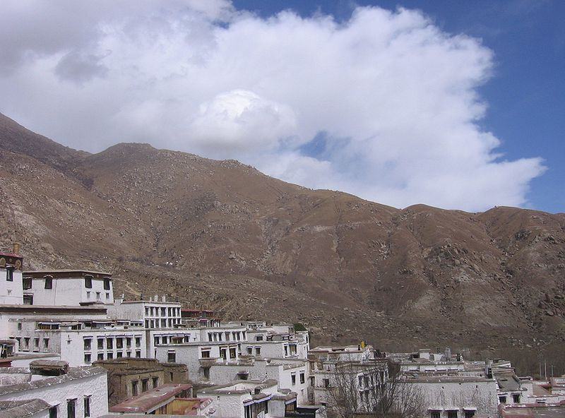 View of Tibet's Drepung 'Bras-spungs, Zhaibung' Monastery, on the outskirts of Lhasa, and the surrounding mountains