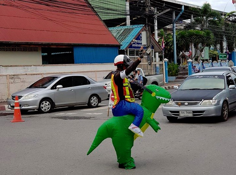 Traffic police appears to ride a dinosaur in Nakhon Nayok
