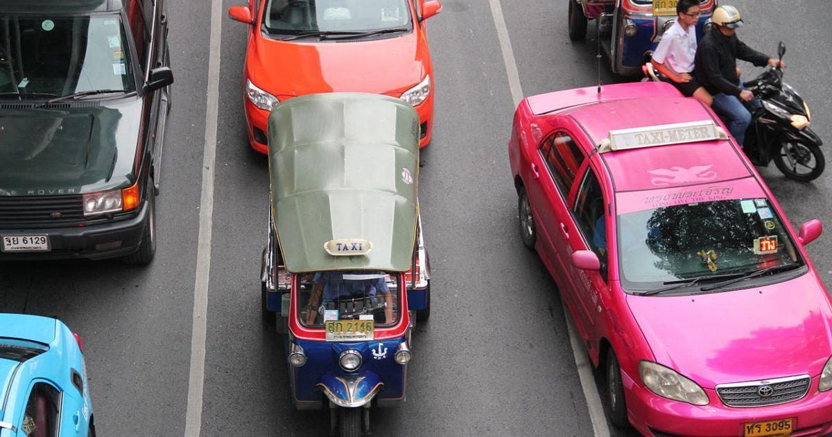 A tuk tuk and a taxi in Bangkok