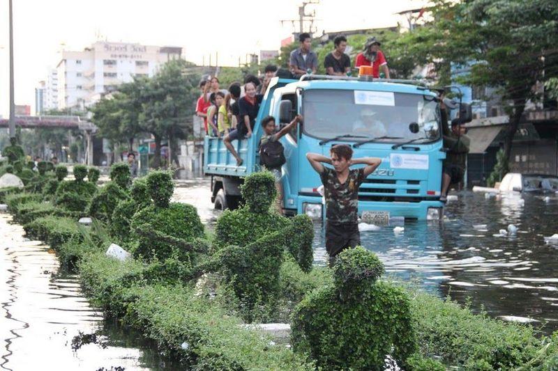 Bangkok residents evacuate flooded neighborhoods