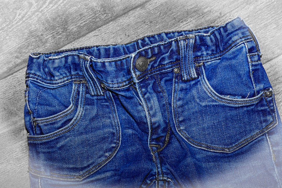 Jeans on a grey wood background