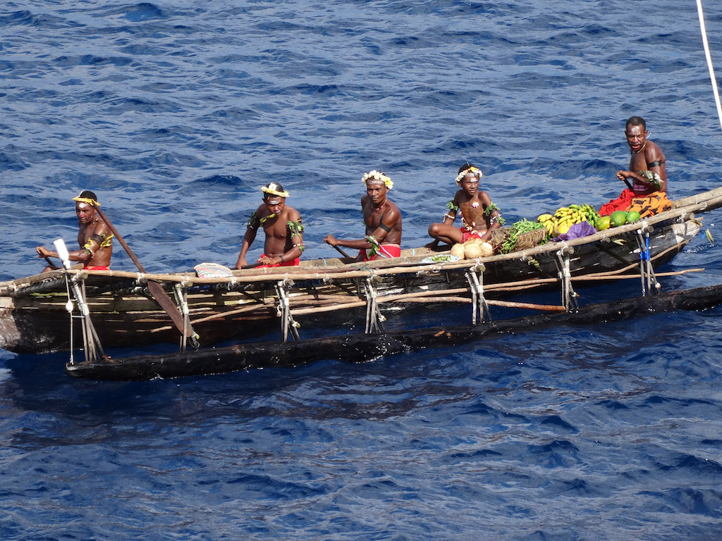 Natives in a boat in Papua New Guinea
