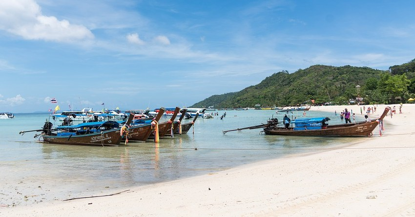 Long-tail boats on a beach