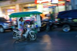 Woman driving a threewheeler in Phuket