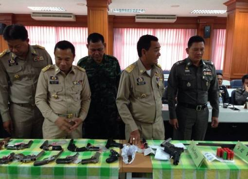 Thai police with seized guns