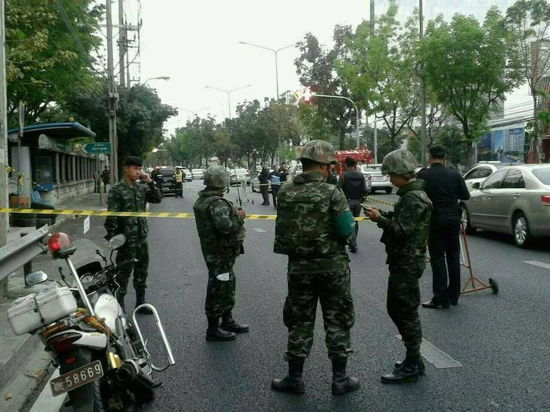 Thai police and soldiers inspecting an area in Bangkok