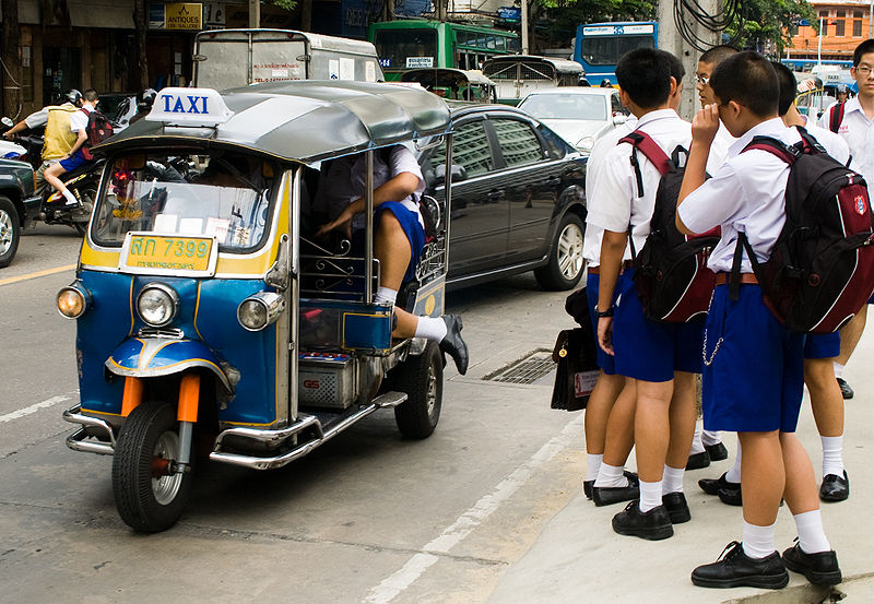 Thai students going to school by tuk tuk