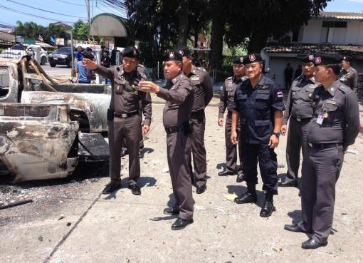 Thai police inspecting burnt out cars