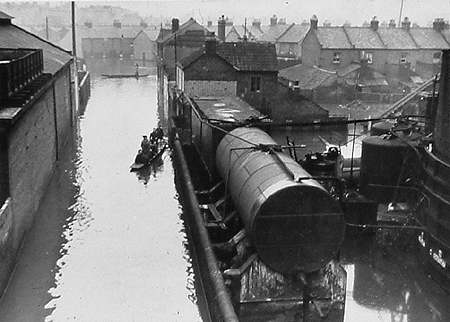 Flooded gasworks with punts