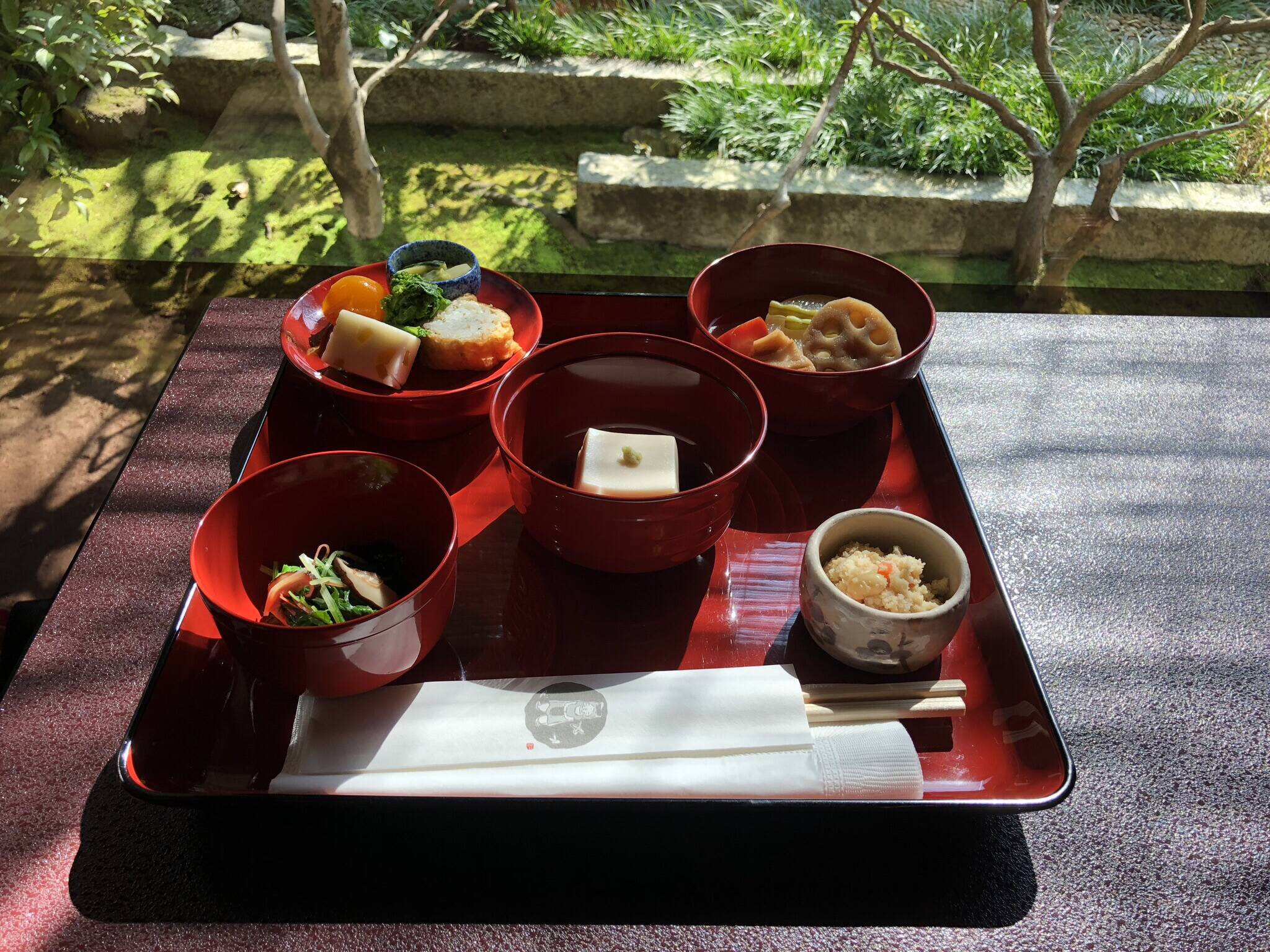 Shojin ryori in red bowls on red platter