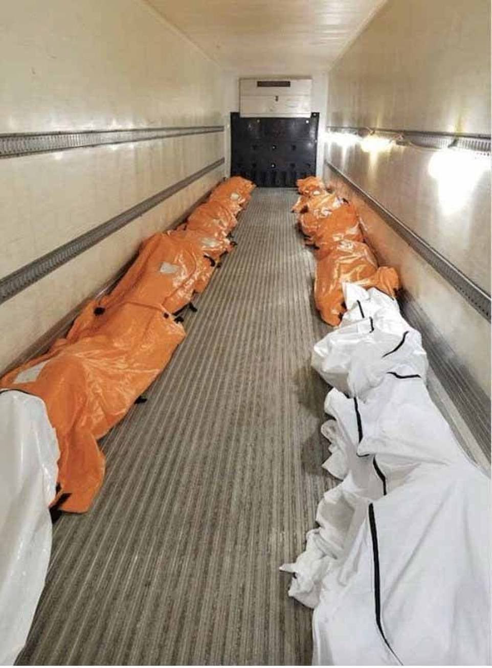 Dead bodies loaded into refrigerated trucks outside New York hospitals after more people die from Coronavirus in seven hours