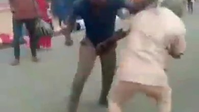Two grown men took to the streets to fight each other over a woman.