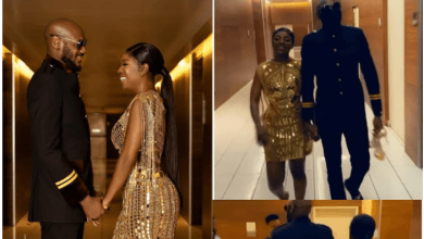 2face Idibia holds wife, Annie Idibia's shoes for her as they left the Headies award ceremony