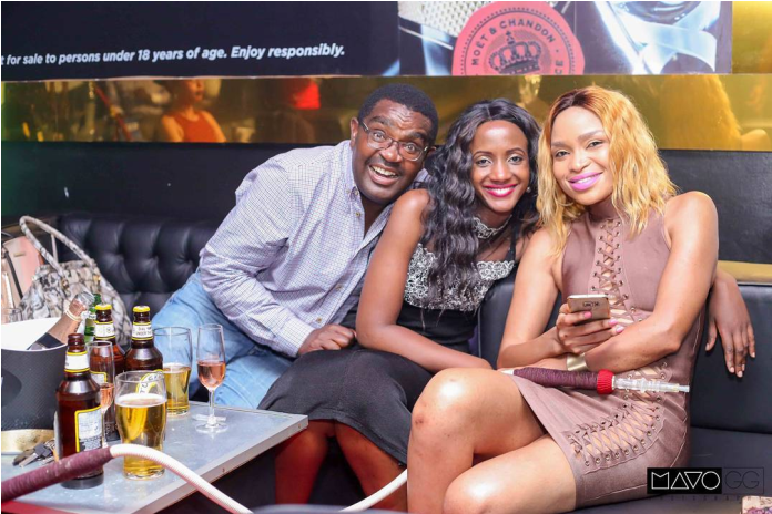 Whose husband is this? Is his wife aware he was spoiling slay queens over the weekend in a city club? (PHOTO).