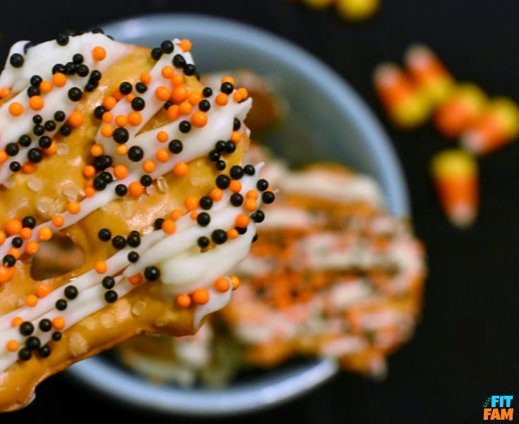 easy yogurt covered pretzels are perfect for Halloween party food! They are so easy, yummy, and a great healthy snack! My favorite guilt free Halloween treat!