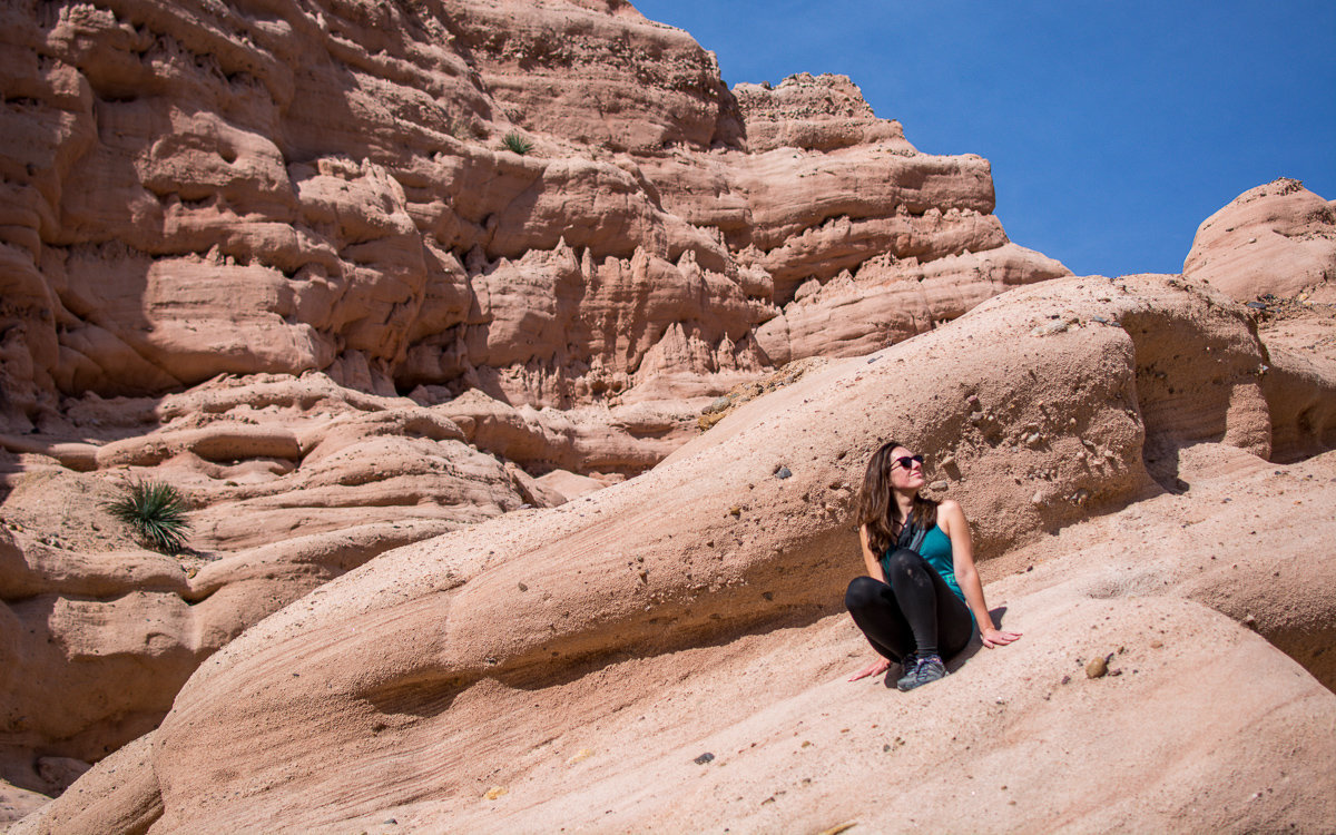 Sitting on the rocks in the canyon of Red Rock Canyon Trail