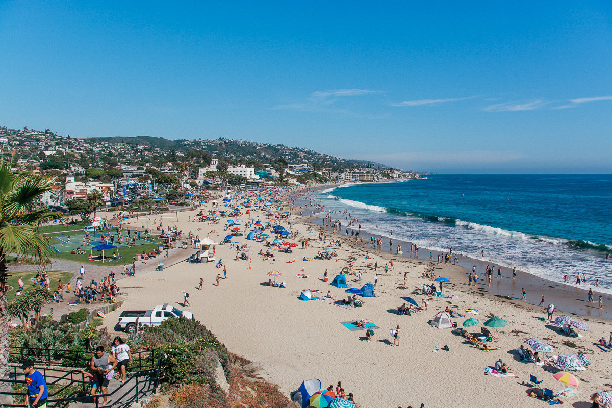 An overview of the busy Main Beach on a summer day.