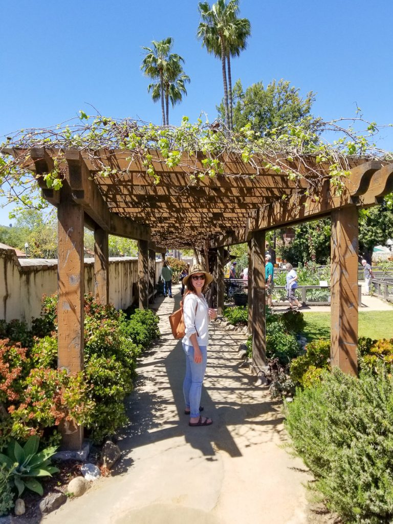 Walking through the gardens at the Mission San Juan Capistrano