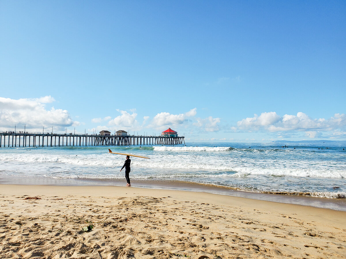 A surfer at the Huntington Beach Pier