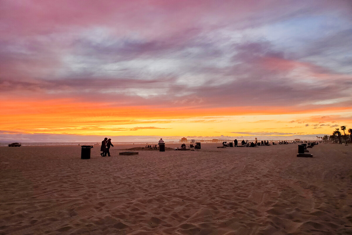 Public fire rings in Huntington Beach at sunset