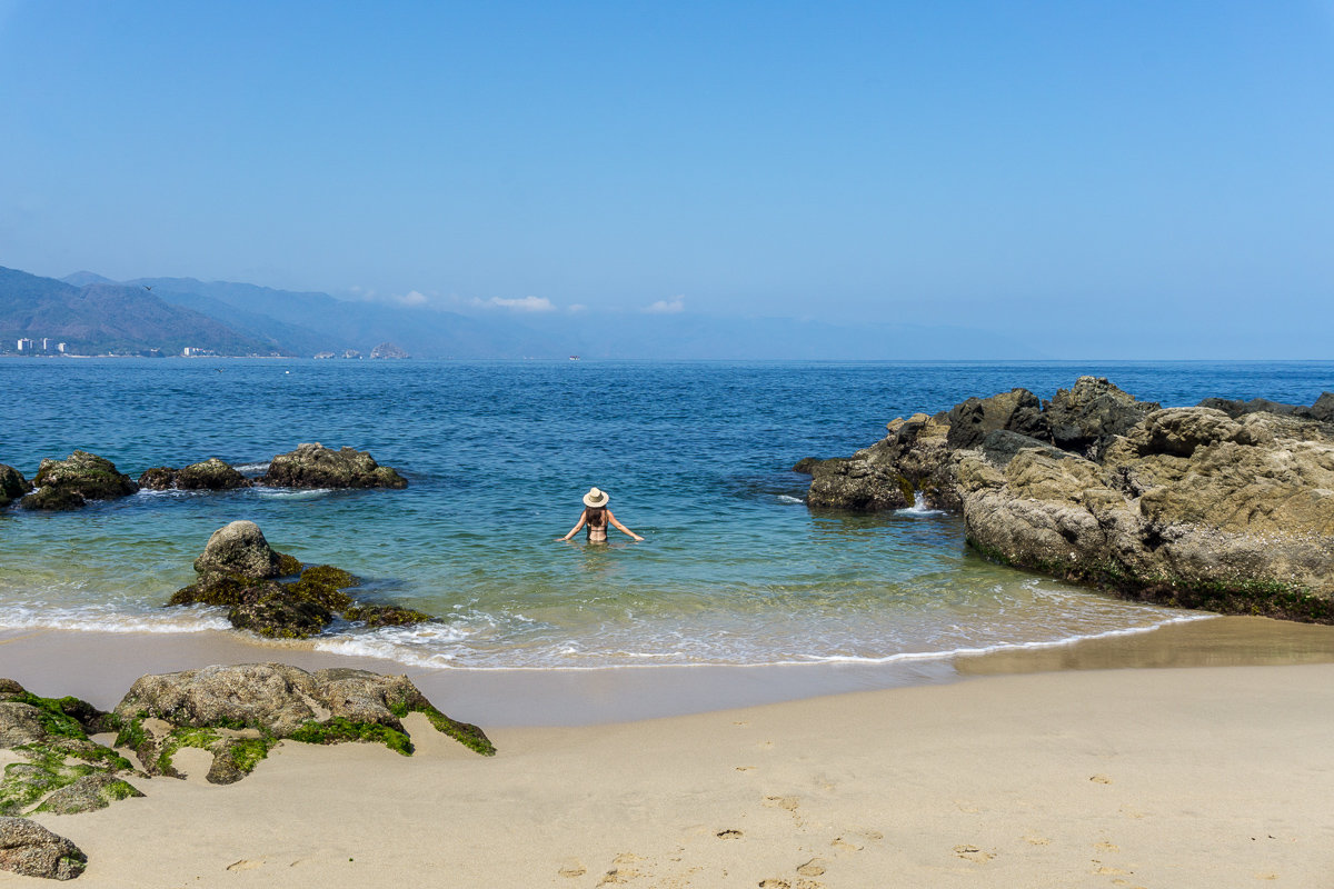 Swimming in the ocean at Conchas Chinas Beach