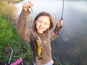 Abby with a yellow bullhead (Souris River, Manitoba, Canada)